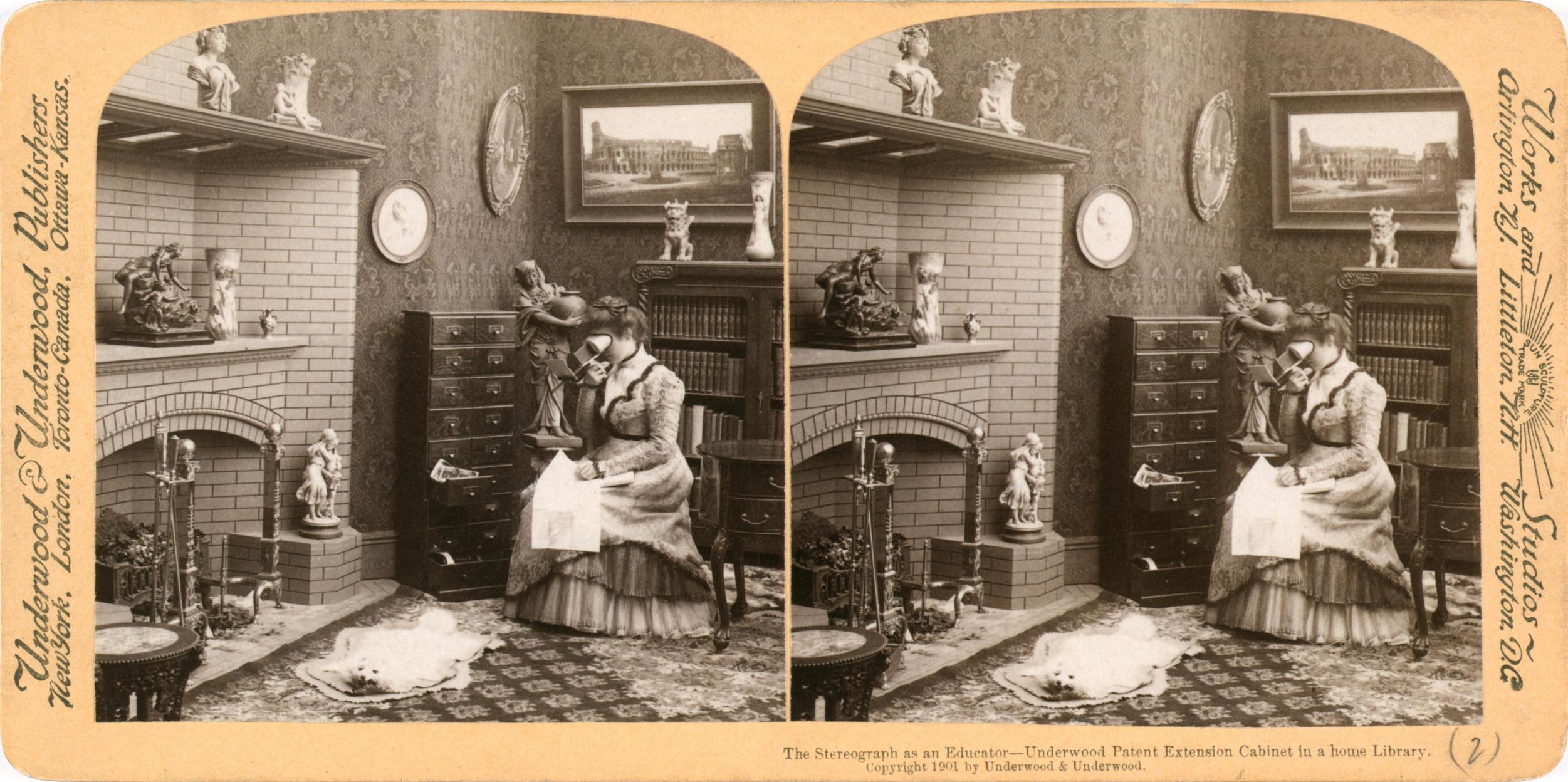 """The stereograph as an educator - Underwood patent extension cabinet in a home library."" Library of Congress description: ""Photograph shows a woman viewing stereographs in her home; she is sitting in front of a fireplace with a cabinet for stereographs on her right."" Date1901 SourceLibrary of Congress Prints and Photographs Division, Stereograph Cards collection. http://hdl.loc.gov/loc.pnp/ppmsca.08781, Underwood & Underwood, PD-US"