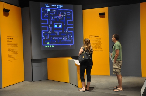 Visitors interacting with the Art of Video Games exhibition at the Brooks Museum. (Source: Memphis Brooks Museum of Art)