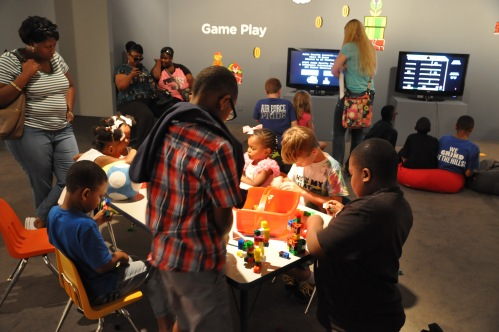 Families in the interactive gallery during a Wacky Wednesday event.